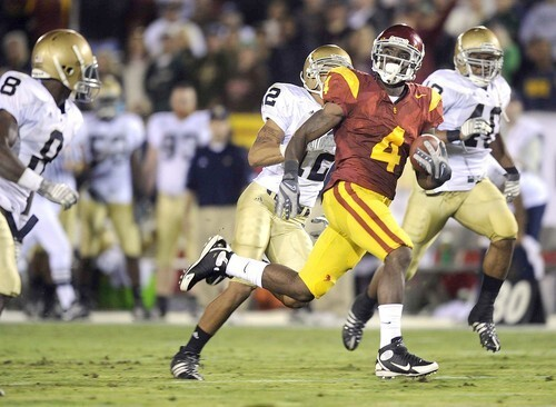 USC tailback Joe McKnight breaks into the clear against Notre Dame's defense during a 55-yard touchdown run in the second quarter Saturday.