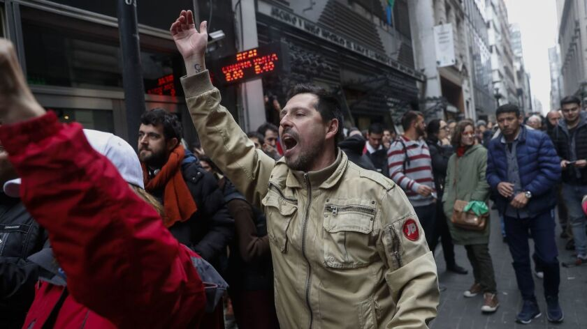 Public workers demonstrate in front of the delegation of the Ministry of Justice in Buenos Aires on Sept. 3. The workers reject the decision of Argentina's president, Mauricio Macri, to cut government hiring and subsidies.