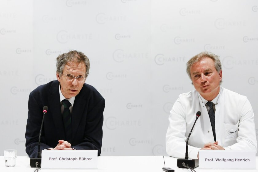 Christoph Buehrer, left, director of neonatology at Charite Hospital and Wolfgang Henrich, director of gynecology at Charite Hospital, brief the media about the situation of 65-year old mother Annegret Raunigk and her quadruplets, in Berlin, Germany, Wednesday, May 27, 2015. The 65-year-old teacher from Berlin has given birth to a girl,Neeta and three boys, Dries, Bence and Fjonn, by cesarean section at the hospital on Tuesday May 19, 2015. (AP Photo/Markus Schreiber)