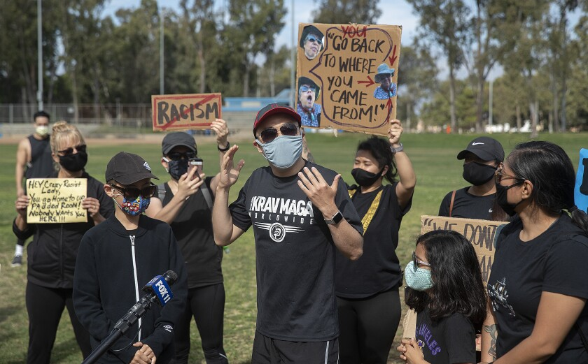 Protesters gather at Charles H. Wilson Park in Torrance to condemn an anti-Asian rant against a parkgoer.