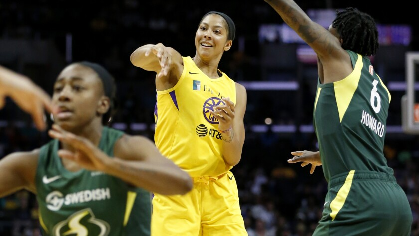 Sparks star Candace Parker passes to a teammate during Sunday's win over the Seattle Storm.