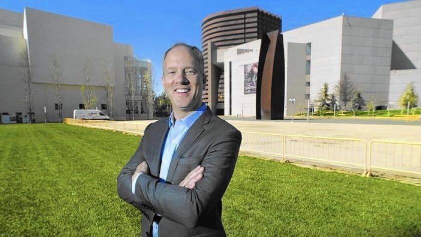 Todd Smith, director and chief executive of the Orange County Museum of Art, stands at the museum's planned future site at the Segerstrom Center for the Arts in Costa Mesa.