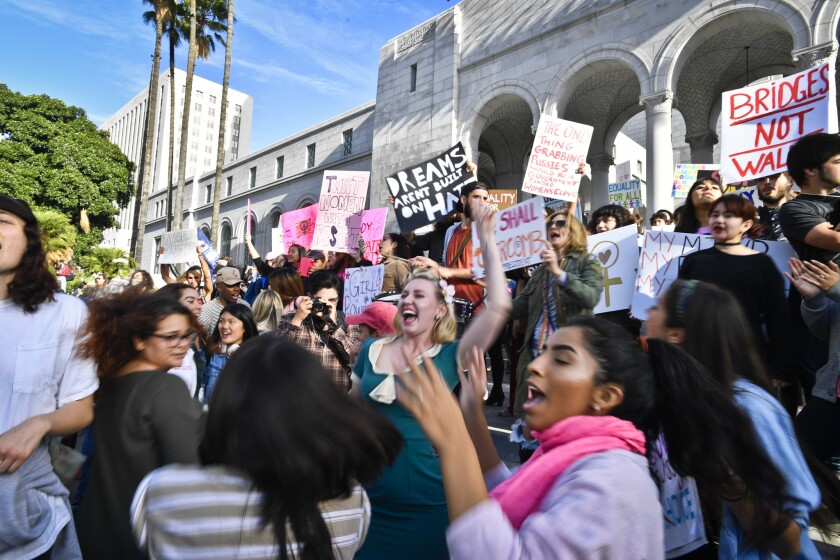 Demonstrators line the steps of City Hall while chanting slogans and dancing after the women's march in downtown Los Angeles.