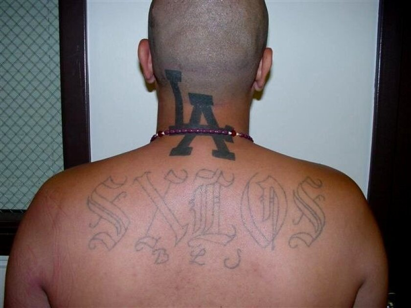 Examples of gang tattoo markings among the 65 gang members, gang associates and criminal aliens rounded up in a week-long operation led by U.S. Immigration and Customs Enforcement (ICE).