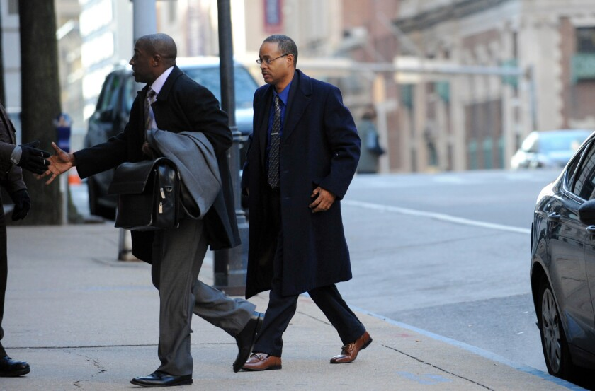 Caesar Goodson, right, arrives at Courthouse East in Baltimore on Jan. 6, 2016, for a motions hearing ahead of the trial for Goodson, who drove the police transport van where Freddie Gray was critically injured.