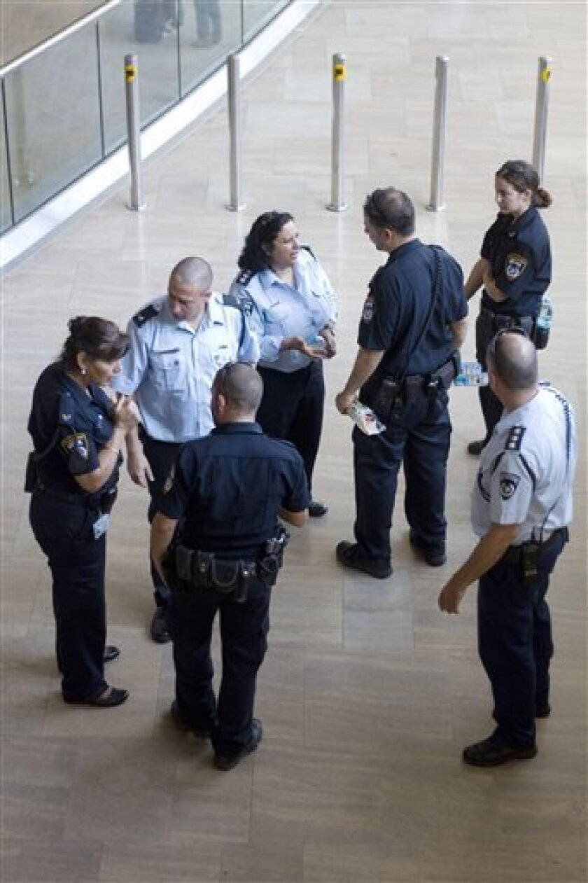 Israeli police officers stand at the arrival hall at Ben Gurion airport near Tel Aviv , Israel, Wednesday, July 6, 2011 . Israeli police said Wednesday they would reinforce security at the country's already heavily fortified international airport before hundreds of pro-Palestinian activists arrive this week. Israeli officials say the activists, due to land on Friday at the Ben-Gurion International Airport, are coming spoiling for a fight. The protesters accuse Israel of distorting their message, insisting their activities would be peaceful. (AP Photo/Ariel Schalit)