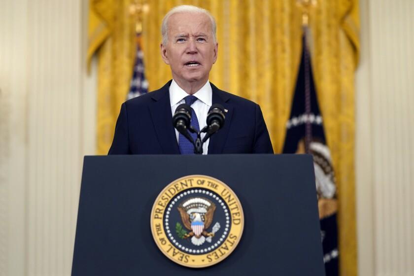 President Biden speaks at a lectern.