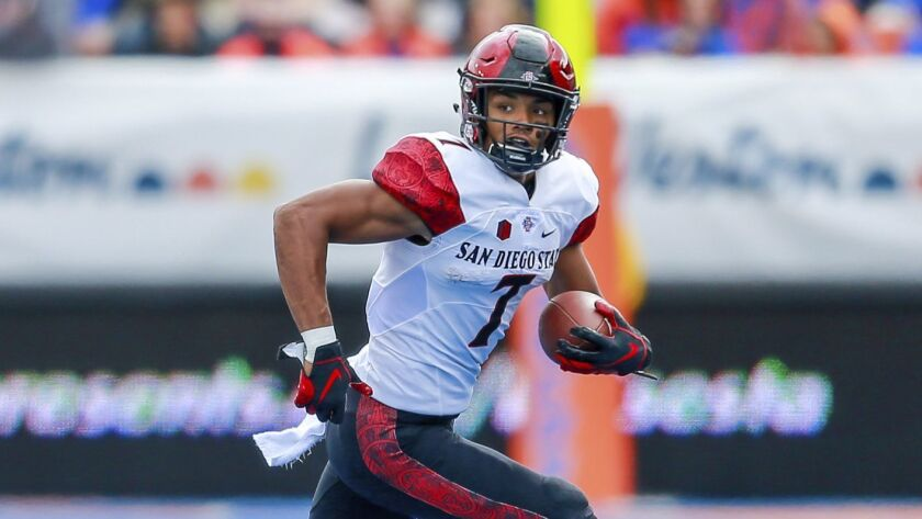 San Diego State wide receiver Fred Trevillion (7) runs after a reception in the first half of an NCA