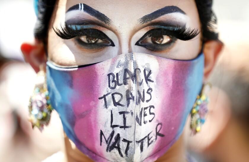 "Jason De Puy of West Hollywood wears a face mask that reads ""Black Trans Lives Matter"""