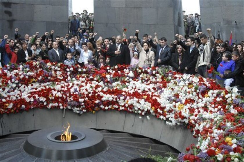 FILE - In this April 24, 2009 file photo, Armenians gather to mark the 94th anniversary of the mass killing of the Armenian people, at a monument in Yerevan. President Barack Obama is facing a bind as a congressional panel prepares a vote next week on a resolution that would recognize the World War I-era killings of Armenians by Ottoman Turks as a genocide. (AP Photo/ Mkhtar Khachatryan/Photolure, File)