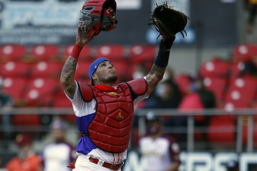 Puerto Rico's Yadier Molina reacts after tagging out Venezuela's Ali Castillo during the first inning of a Caribbean Series baseball game at Teodoro Mariscal Stadium in Mazatlan, Mexico, Monday, Feb. 1, 2021. (AP Photo/Moises Castillo)