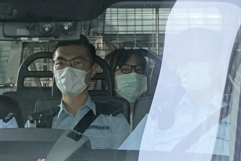 Police in van with arrested democracy activist