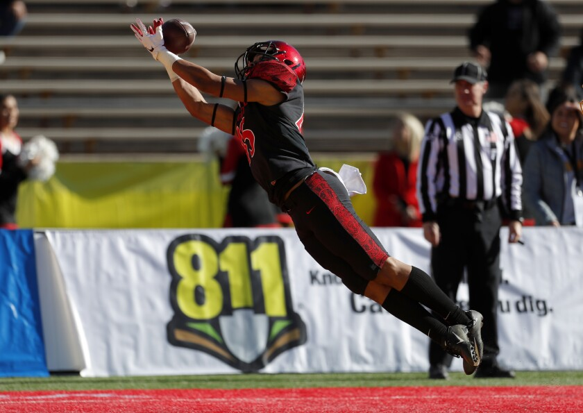 San Diego State wide receiver Jesse Matthews dives for a 22-yard touchdown reception from quarterback Ryan Agnew, opening the scoring in the first quarter against Central Michigan in the New Mexico Bowl.