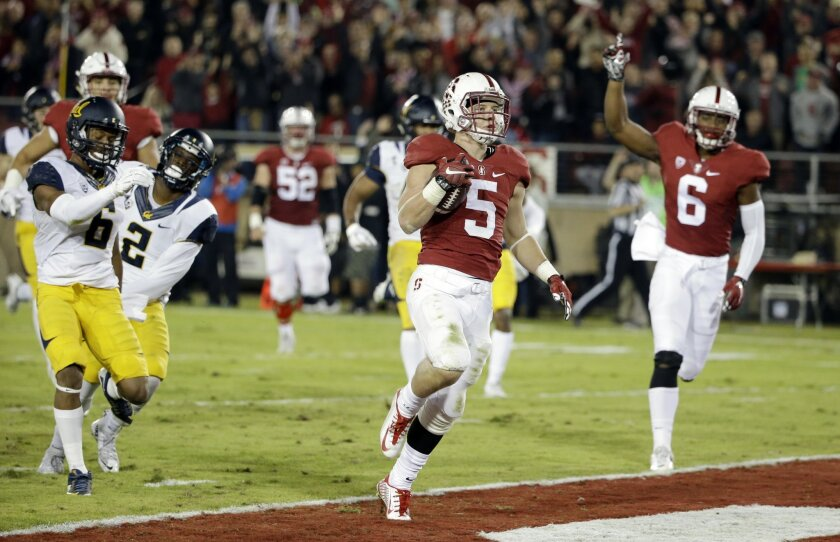 Stanford running back Christian McCaffrey (5) scores a touchdown on a 49-yard catch against California during the first half of an NCAA college football game Saturday, Nov. 21, 2015, in Stanford, Calif. (AP Photo/Marcio Jose Sanchez)