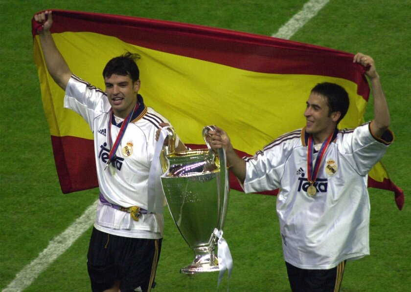 FILE - In this Wednesday May 24, 2000 file photo, Real Madrid's Fernando Morientes, left, and Raul Gonzalez celebrate their team's victory in the final of the Champions League against FC Valencia at the Stade de France in Saint Denis, north of Paris. Real Madrid ran out comfortable 3-0 winners with goals from Morientes, Raul and England's Steve McManaman. The final was the first involving teams from the same country. On Saturday, May 28, 2016, Real Madrid will meet city rival Atletico Madrid in the final in Milan, Italy, the sixth time in history that the final is contested by teams from the same country. (AP Photo/Remy de la Mauviniere, File)