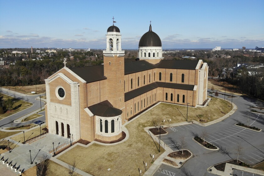This Wednesday, Jan. 27, 2021, photo shows the Holy Name of Jesus Cathedral in Raleigh, N.C. So far, Congress has committed nearly $1 trillion in relief. An Associated Press investigation found that the Roman Catholic Church, one of the world's largest institutions, was perhaps the biggest beneficiary. (AP Photo/Allen G. Breed)