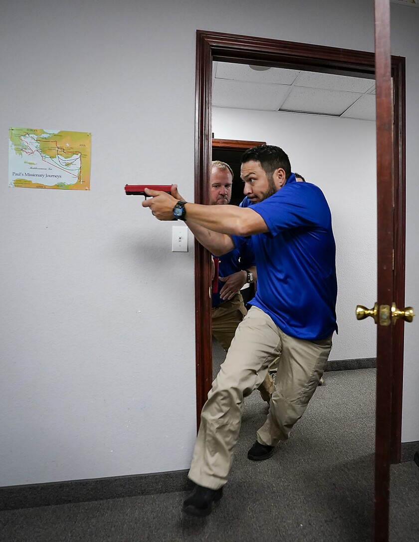 Instructor demonstrates how to enter an active room during security training at Texas church