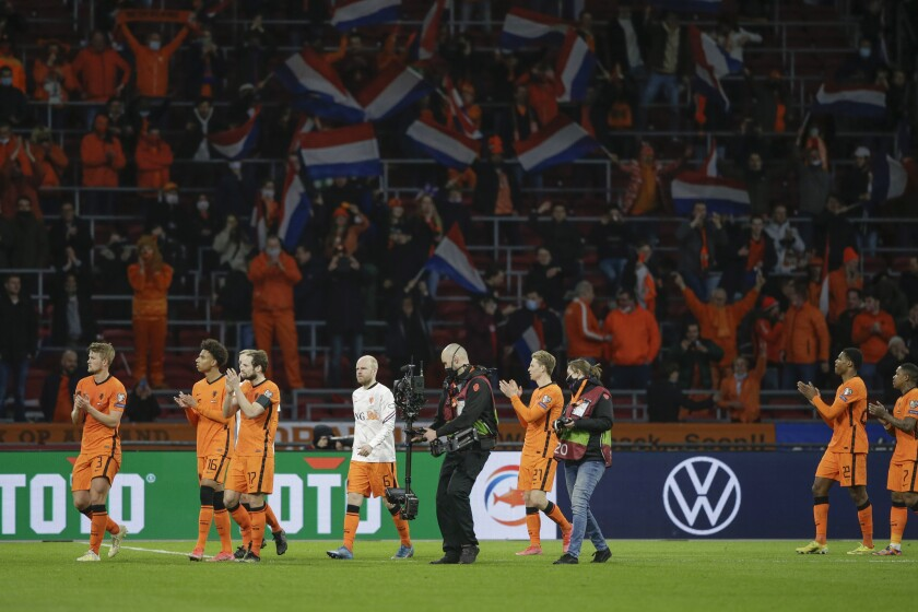 Netherlands' players cheer supporters at the end of the World Cup 2022 group G qualifying soccer match between The Netherlands and Latvia at the Johan Cruyff ArenA in Amsterdam, Netherlands, Saturday, March 27, 2021. Netherlands won 2-0. (AP Photo/Peter Dejong)