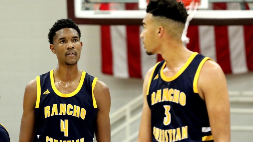 Rancho Christian's Evan Mobley (4) is seen with his brother Isaiah (3) during a game at the Hoophall Classic.