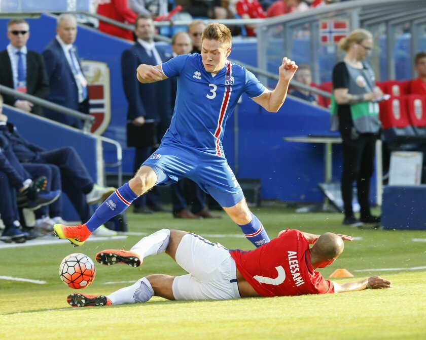 Norway's Haitam Aleesami on the ground, with Iceland's Haukur Heidar Hauksson during their friendly soccer match between Norway and Iceland at Ullevaal Stadium in Oslo, Norway, Wednesday June 1, 2016.? (Terje Pedersen / NTB scanpix via AP) NORWAY OUT