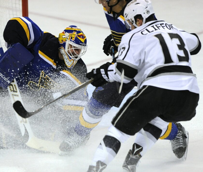St. Louis Blues goalie Brian Elliott (1) blocks a shot by Los Angeles Kings' Kyle Clifford (13) during the second period of an NHL hockey game Thursday, Feb. 18, 2016, in St. Louis. (AP Photo/Bill Boyce)
