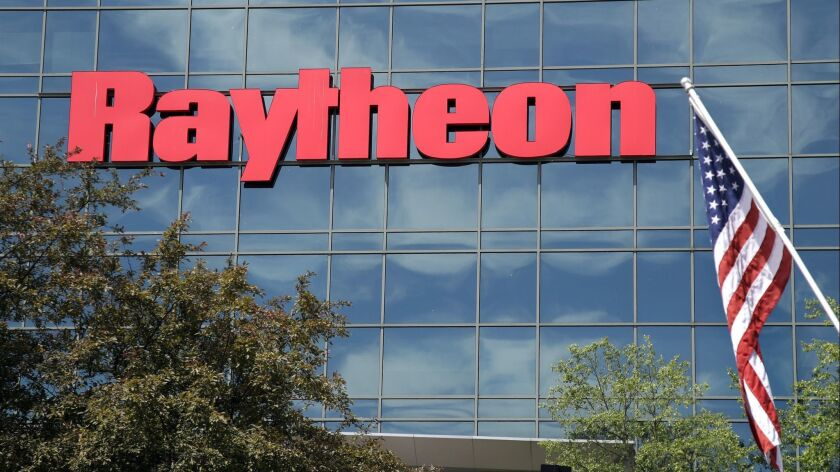 And American flag flies in front of the facade of Raytheon's Integrated Defense Systems facility, Mo