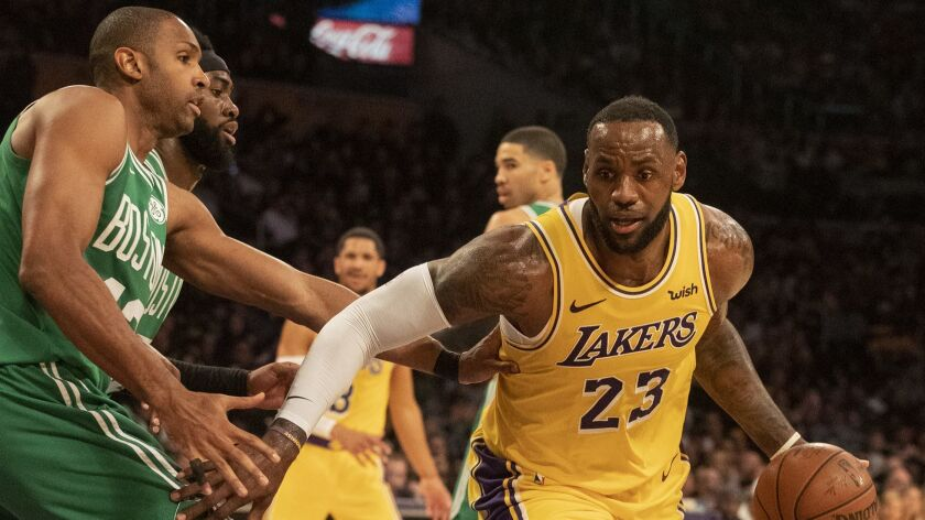 LeBron James drives to the basket as the Celtics' Al Horford defends in the fourth quarter at Staples Center.