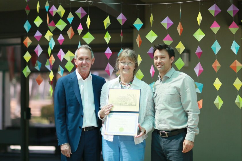New Volunteer of the Year awardee Lynn Jahn (center) with International Center dean Kirk Simmons representing UCSD Chancellor Pradeep Khosla and assistant director of international faculty Kevin del Mastro