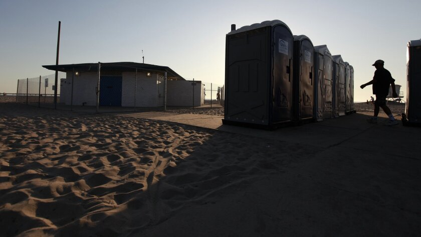 Public restrooms in Ocean Beach have been condemned and fenced off. Portable restrooms have been moved to the site. (John R. McCutchen / Union-Tribune)
