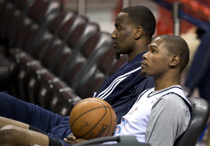 Then-Oklahoma City Thunder teammates Kendrick Perkins, left, and Kevin Durant in 2012.