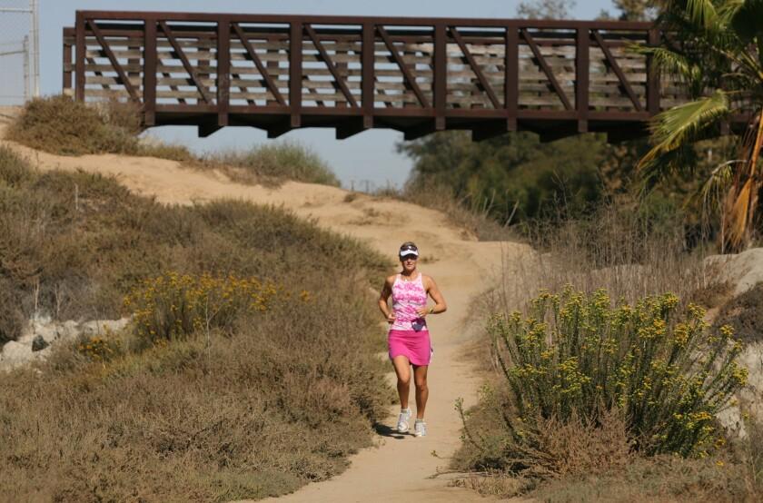 A woman runs on a trail in Newport Beach's Back Bay in 2008.