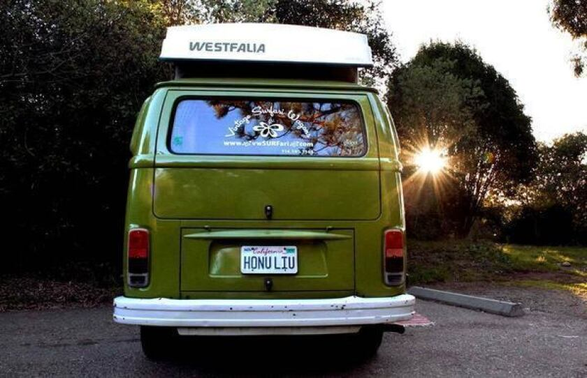 Smiles and smiles to go in a vintage VW bus