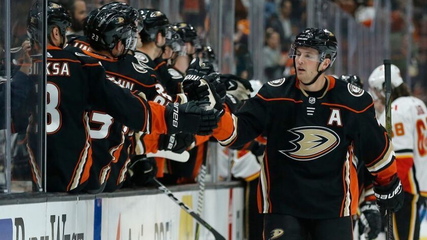 Ducks defenseman Cam Fowler, right, celebrates scoring against the Calgary Flames during a game on Dec. 29, 2017.