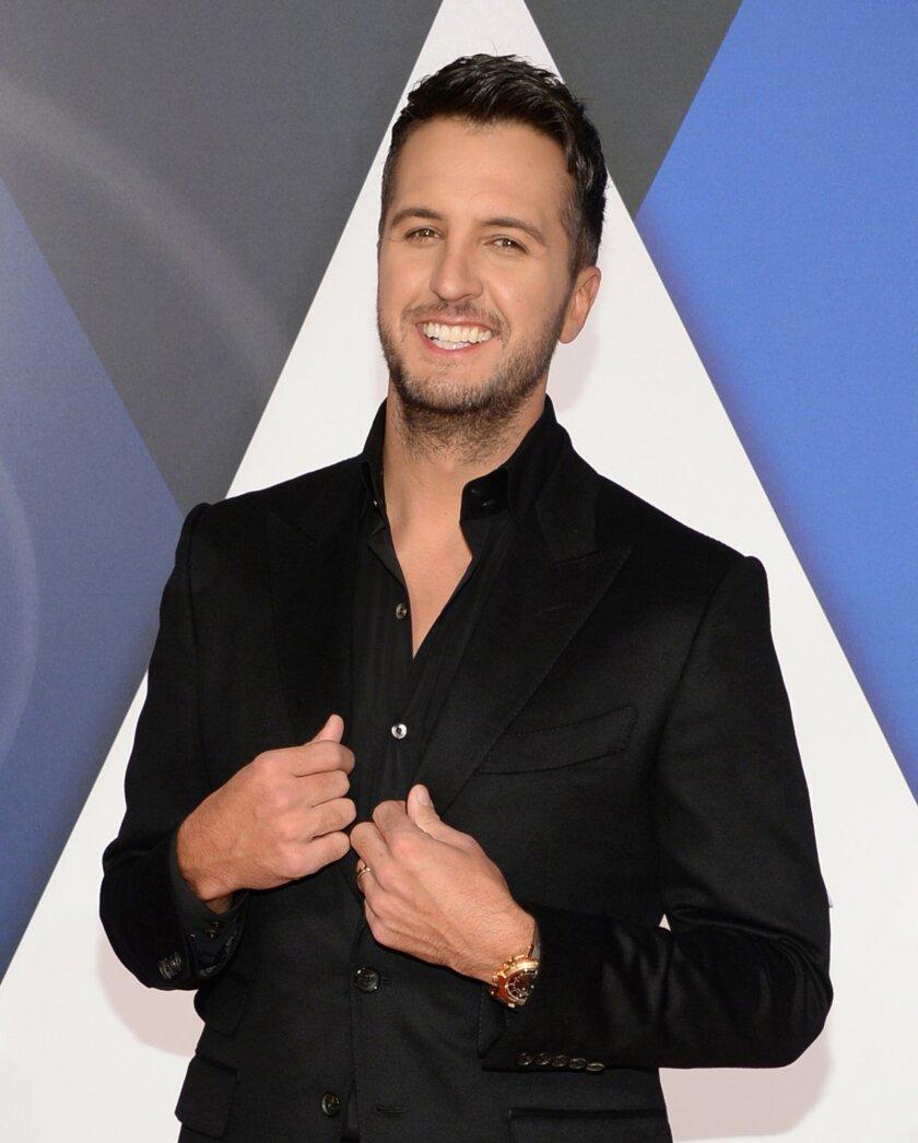 Luke Bryan arrives at the 49th annual CMA Awards at the Bridgestone Arena on Wednesday, Nov. 4, 2015, in Nashville, Tenn. (Photo by Evan Agostini/Invision/AP)