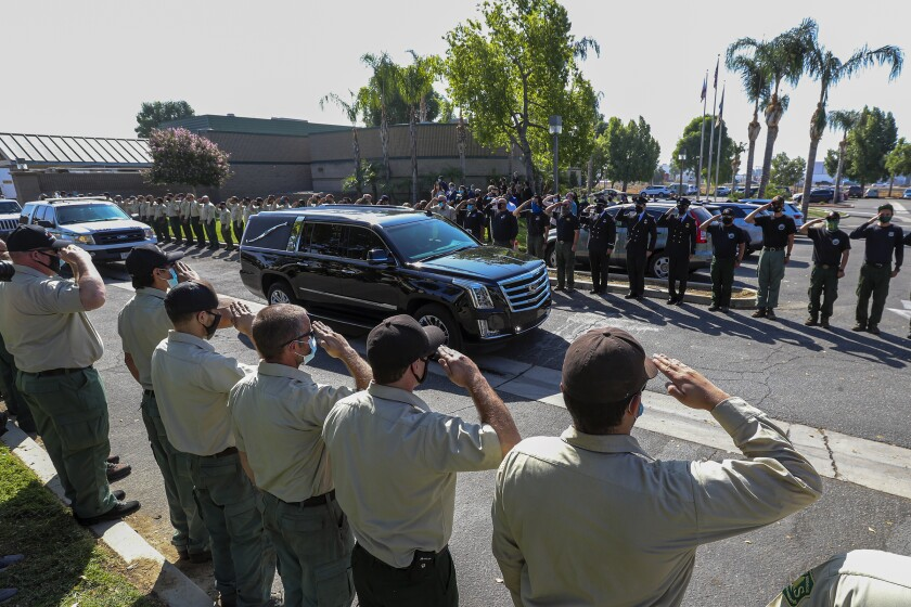 A hearse carrying the casket of fallen Big Bear Interagency Hotshot Charles Morton leaves Tuesday from San Bernardino