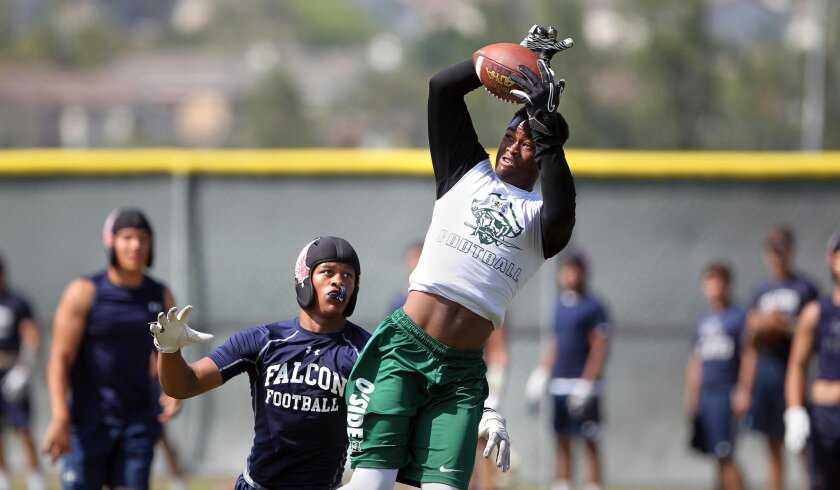 Oceanside's Kyrin Beachem hauls in a pass during summer passing league action.