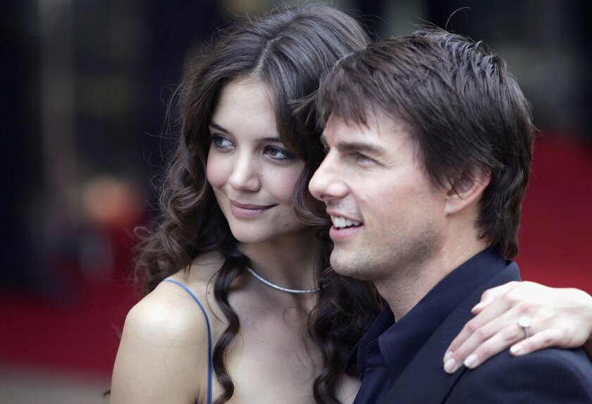 """Katie Holmes and Tom Cruise arrive at the """"War Of The Worlds"""" premiere."""