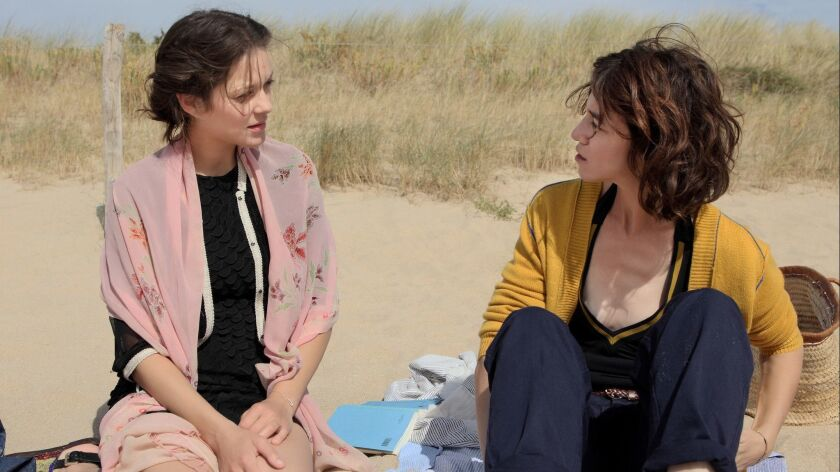 "Marion Cotillard and Charlotte Gainsbourg in the movie ""Ismael's Ghosts."""