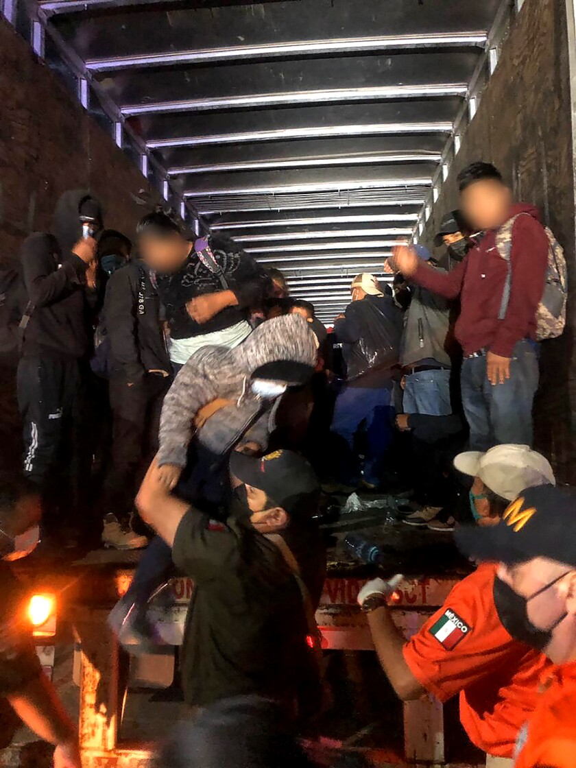 Police rescue 201 migrants in the back of a big rig in Mexico's southern Chiapas state