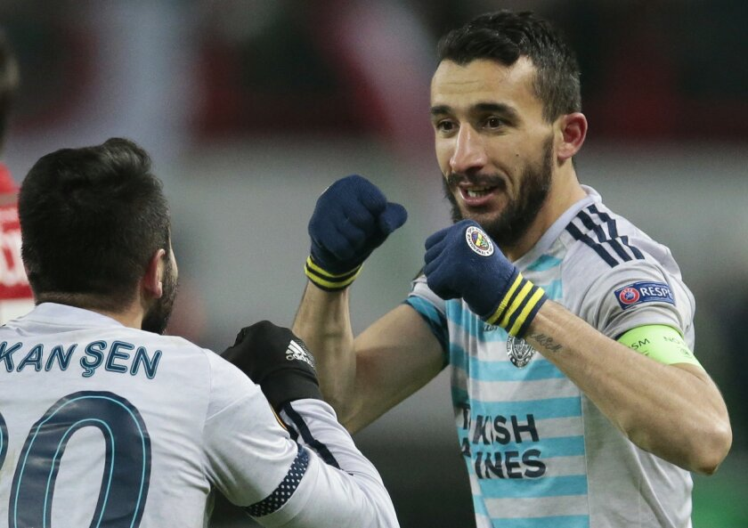 Fenerbahce's Mehmet Topal, right, celebrate after scoring a goal with Volkan Sen during the Europa League second leg round of 32 soccer match between Lokomotiv Moscow and Fenerbahce at Lokomotiv stadium in Moscow, Russia, Thursday, Feb. 25, 2016. (AP Photo/Ivan Sekretarev)