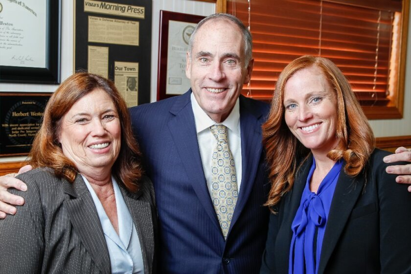 Attorney Herb Weston (middle) with his wife Jackie (left) and daughter Tanya Weston, also an attorney, at their Vista law offices Wednesday.