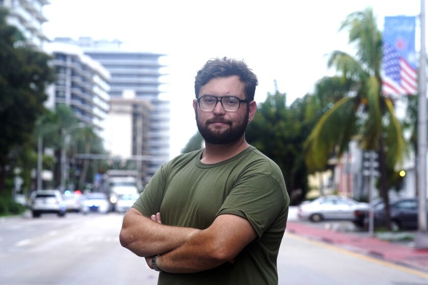 Ryan Mermer stands near his apartment in the historic section of Surfside, Fla., Tuesday, June 29, 2021. Mermer moved back from Palm Beach County to be near his parents and to be part of an active Jewish community. (AP Photo/Marta Lavandier)