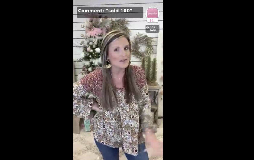 This Nov. 2020 photo shows Jenna Powell live on Facebook. With her three Alabama boutiques closed because of the pandemic, Powell found another way to sell animal print tops and tie-dye hoodies: become an amateur home shopping network host. Almost daily around noon, Powell, or one of her employees, turns on an iPhone, looks into the camera and broadcasts to 400 people watching live on Facebook or her store's app. They put on clothing, spin for the camera and try to get viewers to buy. (Jenna Powell via AP)