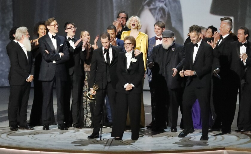 """The cast and crew of """"Game of Thrones"""" on stage accepting the outstanding drama series award during the show at the 70th Primetime Emmy Awards."""