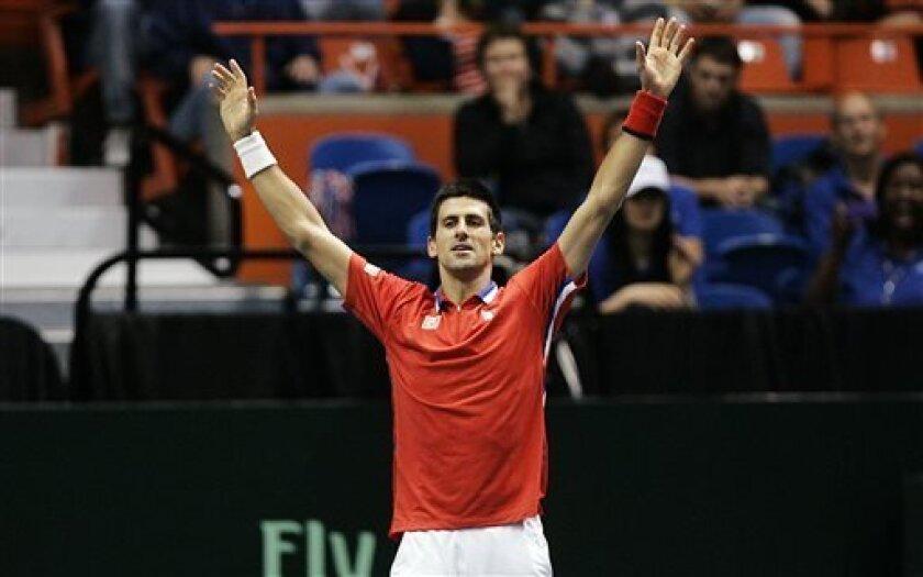 Novak Djokovic, of Serbia, celebrates after defeating Sam Querrey in the Davis Cup tennis tournament, Sunday, April 7, 2013, in Boise, Idaho. (AP Photo/Matt Cilley)