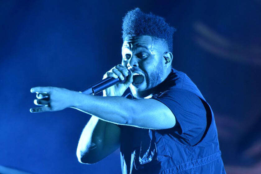 The Weeknd performs on day three at Lollapalooza in Chicago on Aug 4, 2018.
