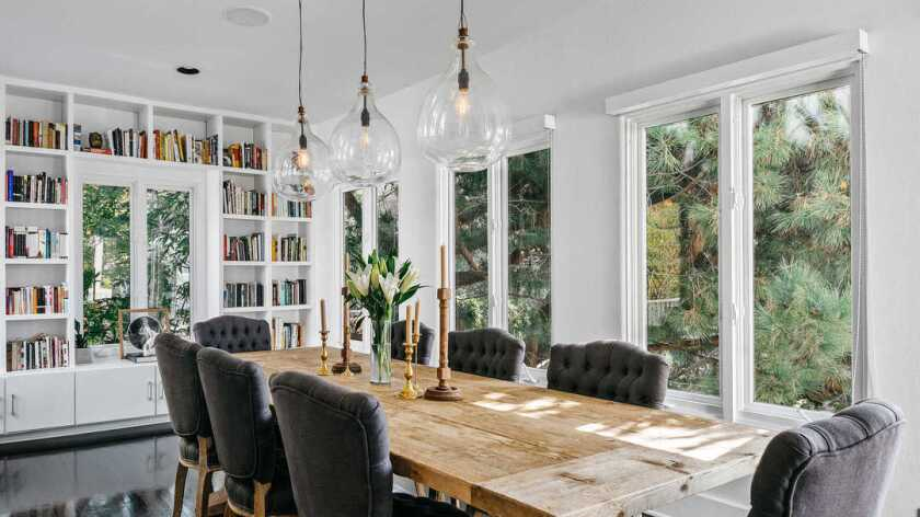 Big windows and white paint give the dining room of Beth Behrs' Hollywood Dell home an open, airy feel.