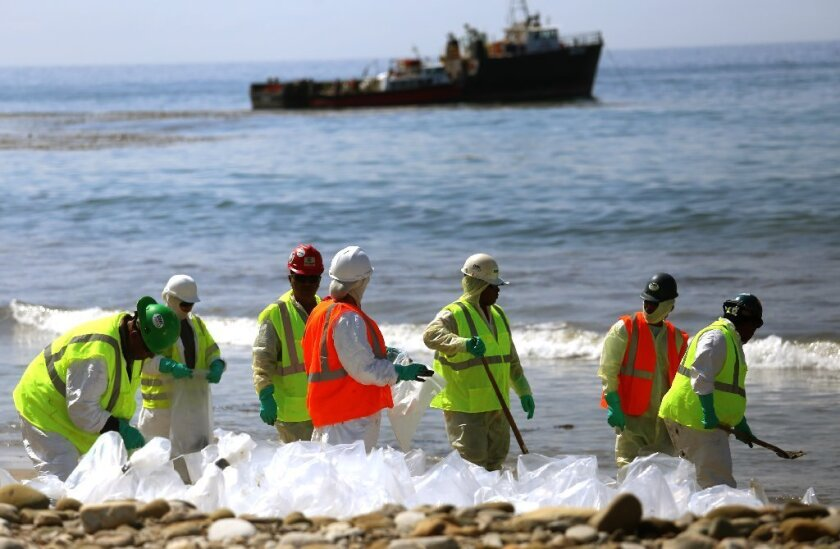Workers continue to clean the shoreline at Refugio State Beach in Santa Barbara County after a crude oil pipeline ruptured on May 19, spilling thousands of gallons into the ocean.