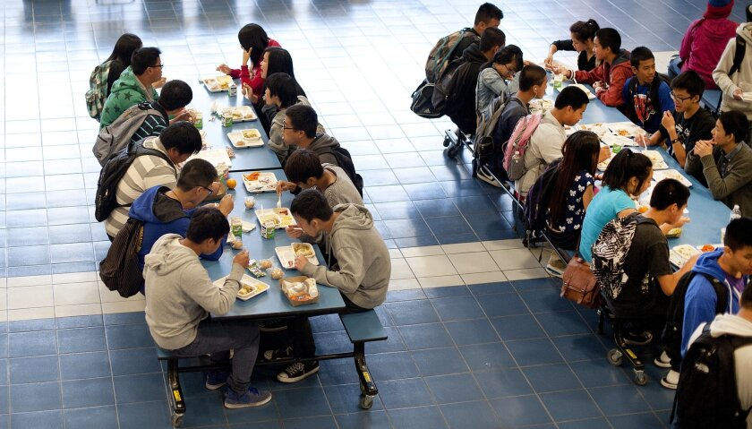 Students eat lunch at a high school in Oakland.
