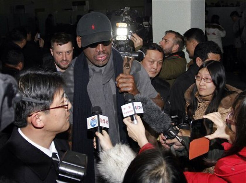 """Flamboyant former NBA star Dennis Rodman is surrounded by journalists upon arrival at Pyongyang Airport, North Korea, Tuesday, Feb. 26, 2013. The American known as """"The Worm"""" arrived in Pyongyang, becoming an unlikely ambassador for sports diplomacy at a time of heightened tensions between the U.S."""